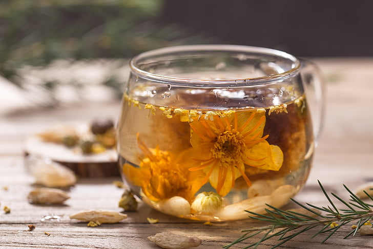 Royalty free photo yellow petaled flowers placed in clear glass yellow petaled flowers placed in clear glass teacup filled with white liquid mightylinksfo