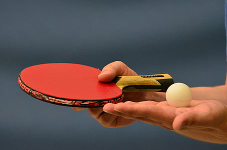 tilt-shift photography of ping pong paddle with ball