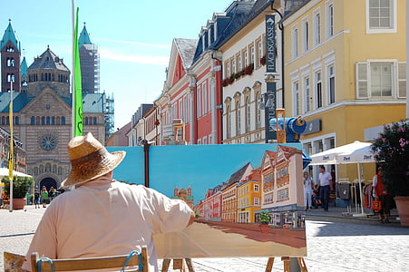 man in white shirt painting buildings