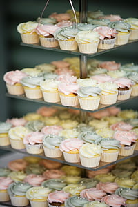 cupcakes with assorted-color icing on glass rack