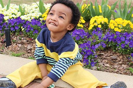 child sitting on ground