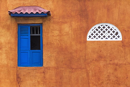 brown painted wall with blue window