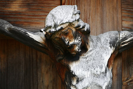 Jesus Christ nailed to the cross wooden statue