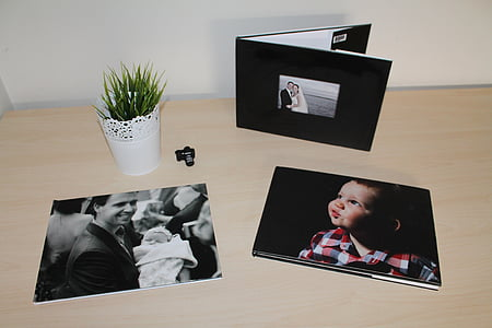 grayscale photos on table