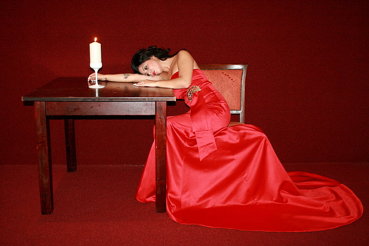 woman wearing red gown sitting on chair