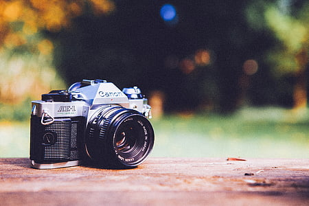 selective focus photography of black and gray Canon AE-1 DSLR camera