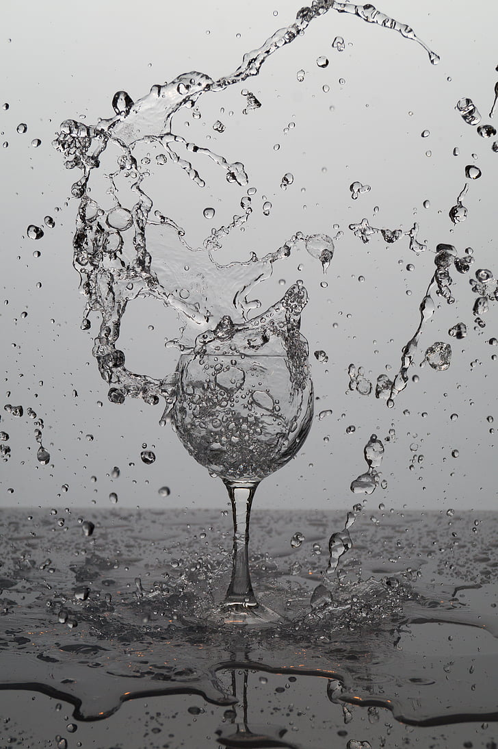 wine glass filled with water explode