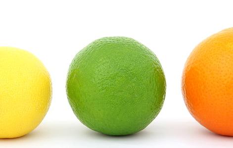 three round citrus fruits