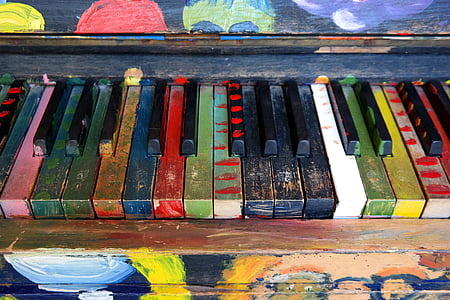 photo of painted black and multicolored piano