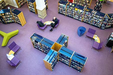 man sitting inside a library