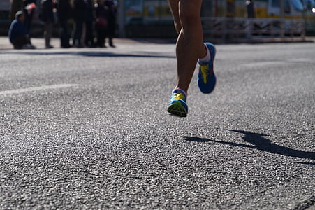 person wearing purple running shoes