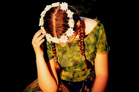 sitting woman wearing flower crown