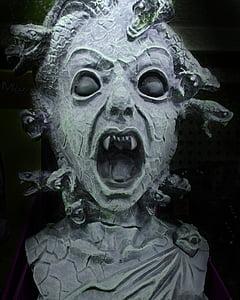 gray medusa bust closeup photo