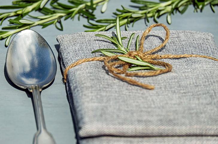 silver spoon beside grey cloth