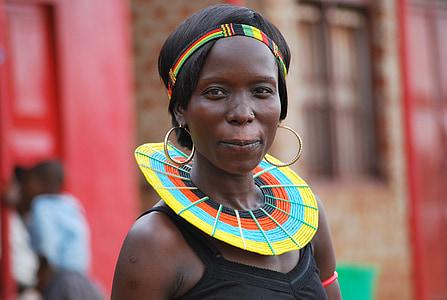 woman wearing black tank top and gold-colored hoop earrings