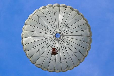 person parachuting on sky