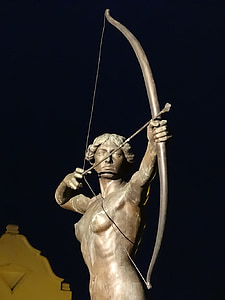 gray statue of man holding composite bow