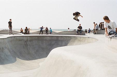 people skateboarding during daytime
