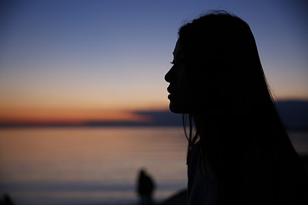 silhouette of woman holding ice cream photography