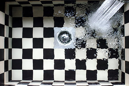 photography of checkered sink with water