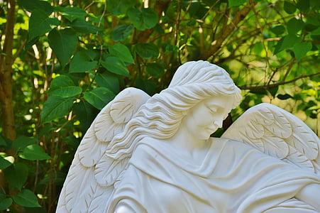 female angel statue near tree
