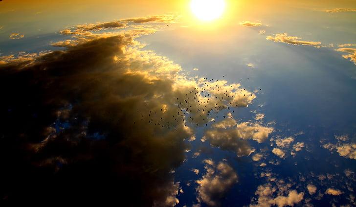 yellow sun beside clouds