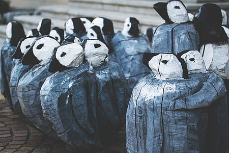 gray-and-white decorative penguins