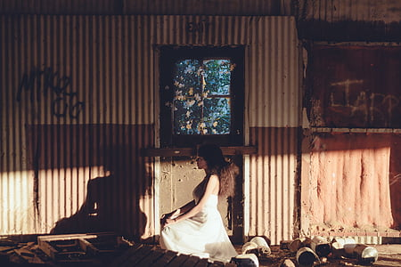 woman in white dress sitting on flooor