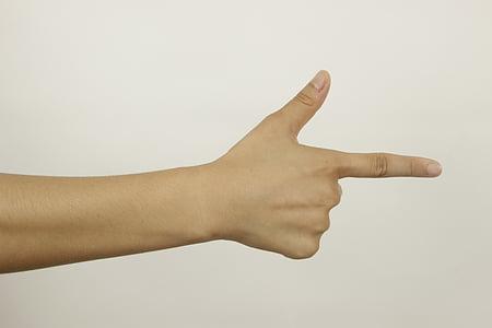 person showing hand gun