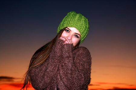 women's green knit cap under sunset