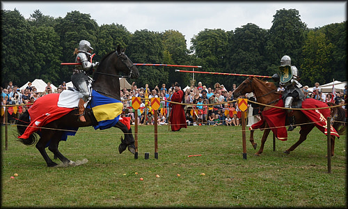 two knights riding on horses with swords