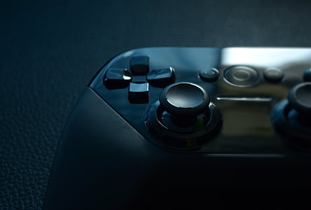 black gamepad on =black top