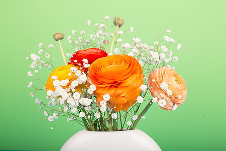 photo of white, orange, pink, yellow, and red petaled flower bouquet