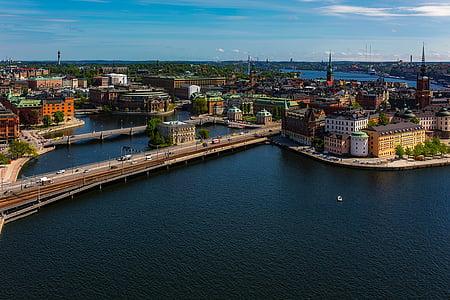aerial photo of cities near sea