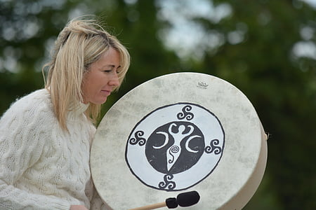 woman holding gong and stick