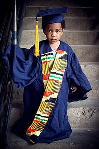 boy wearing academic dress