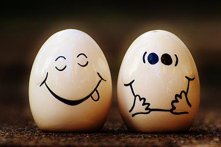 two white ceramic egg trinkets