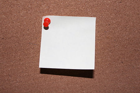 white paper with red cork pin