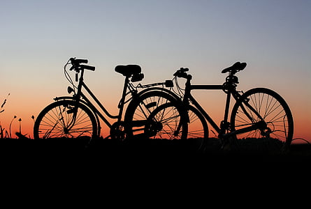 silhouette of two bicycles