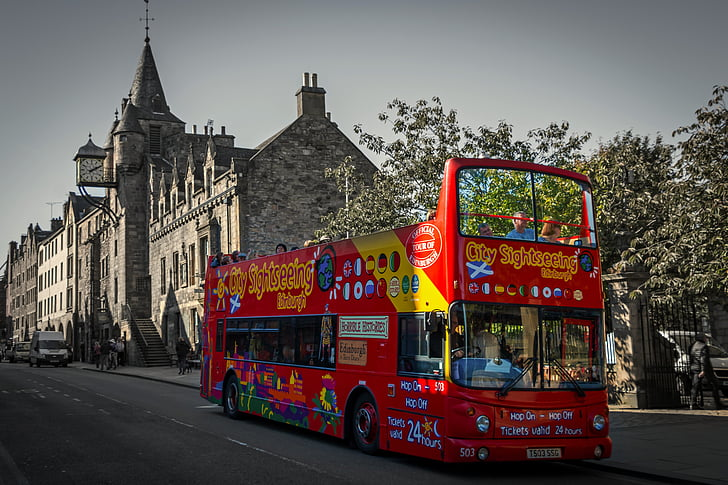 red and yellow double decker bus on concrete road