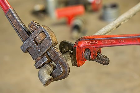 two brown and red RIDGID pipe wrenches