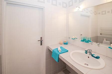 blue towel near sink