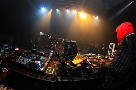 person near DJ controller