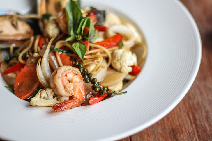 shrimp with vegetable on round white ceramic plate