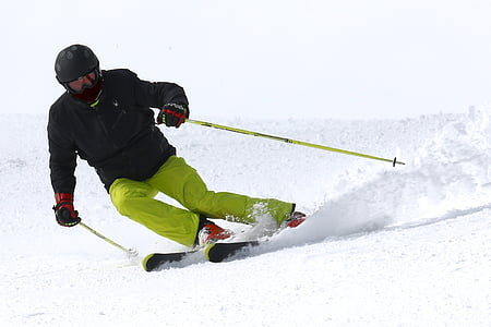 person skiing downhill during daytime