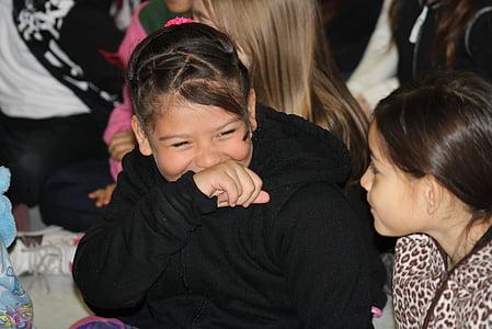 smiling girl talking to girl wearing leopard shirt