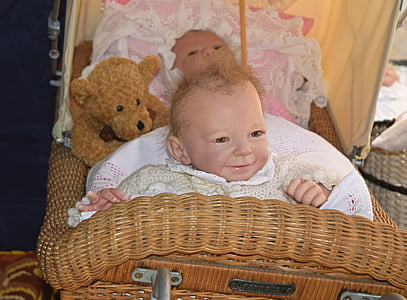 baby on brown wicker bassinet