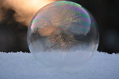 selective photo of bubble on frosted surface