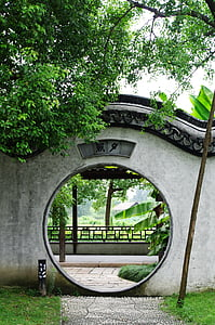 gray and black concrete hole arch