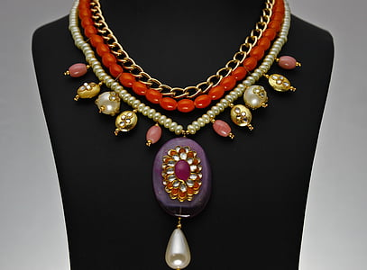 beaded red and white bib necklace with purple and red pendant
